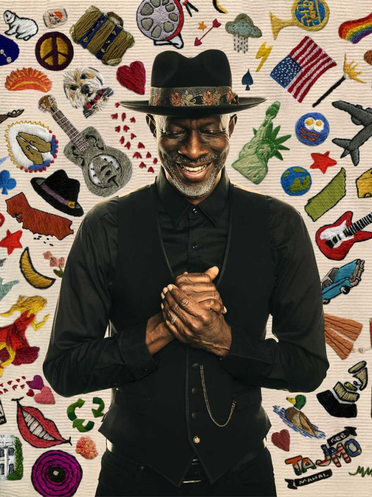 Artist Keb Mo In Front Of A Poster.